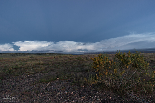 Anticrepuscular rays lead into a line of storms as seen looking west from Seligman, AZ. 6:05 AM / 1305Z