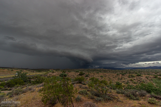 A kink in the gust front develops, leading to a conical lowering. View is to the north from Highway 93. 8:40 AM / 1540Z