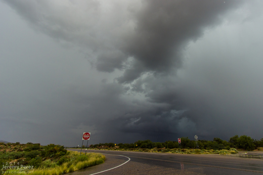 A dark rain free base peeks out from between two rain cores as seen from Highway 93 looking southwest. 9:50 AM / 1650Z