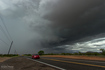 RFD partially obscures the rotating wall cloud on a receding supercell between Wickenburg and Congress. As seen from Highway 89 looking north-northeast. 11:35 AM / 1835Z