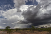 A receding supercell thunderstorm dumps rain and hail over Congress, AZ. As seen from Highway 89 looking north-northeast. 11:45 AM / 1845Z