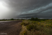 A striated shelf cloud approaches the intersection of Highway 93 and 71. The rain free base on this supercell was obscured by surrounding precipitation. View is to the southwest. 1:05 PM / 2005Z
