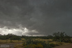 A new updraft base forms to the south of a passing supercell as seen from Highway 71 in Congress, AZ. View is to the southwest. 1:15 PM / 2015Z
